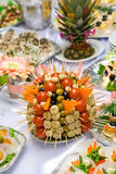 Catering buffet style - tomatoes, mushroomes and o. Catering buffet style - tomatoes mushroomes and olives beautifully decorated on the plate Royalty Free Stock Image