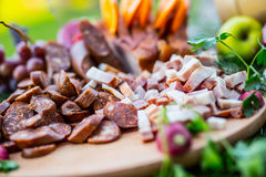 Catering buffet table with a delicious food - bacon sausage vegetable herb decoration Royalty Free Stock Photos