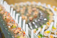 Catering canapé. Catering canape on a glass plate royalty free stock photography