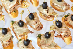 Catering of canape with olives, baguette and meat Royalty Free Stock Image