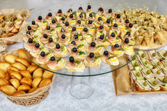 Catering of canape with olives, lemon and salmon Royalty Free Stock Photo