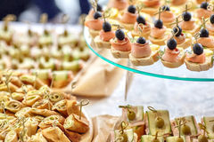 Catering of canape with olives, lemon and salmon Royalty Free Stock Photography