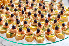Catering of canape with olives, lemon and salmon Stock Image