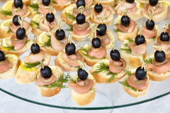 Catering of canape with olives, lemon and salmon Royalty Free Stock Images