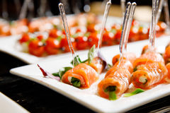 Catering canape salmon basil. White plate Stock Photo