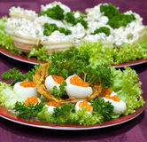Catering - caviar appetizer. In eggs beautifully decorated Royalty Free Stock Image
