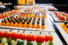 Catering cheese olives canape. White plate Stock Photo