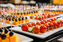 Catering cherry tomatoes canape. White plate Stock Photography