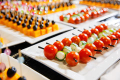 Catering cherry tomatoes canape. White plate Royalty Free Stock Photography