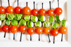 Catering cherry tomatoes canape. White plate Stock Photo