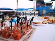 Catering with coktails and glasses on white table. Presentation party stock image