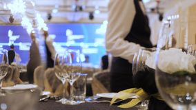 Catering company preparing large numbers of food. Expensive catering. Setting tables at restaurant. Serving tables for