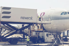 Catering crew and aircraft catering vehicle 2. ATHEN, GREECE - JULY 24, 2016: Catering crew and aircraft catering vehicle serving Qatar aircraft. Airline Royalty Free Stock Photo