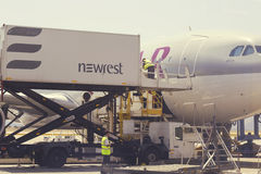 Catering crew and aircraft catering vehicle 4. ATHEN, GREECE - JULY 24, 2016: Catering crew and aircraft catering vehicle serving Qatar aircraft. Airline Stock Image