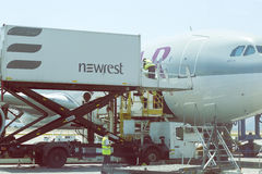 Catering crew and aircraft catering vehicle 3. ATHEN, GREECE - JULY 24, 2016: Catering crew and aircraft catering vehicle serving Qatar aircraft. Airline Royalty Free Stock Photos