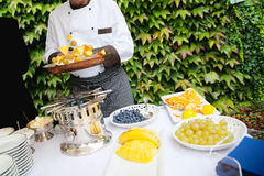 chef is cooking fruit. Outdoor Royalty Free Stock Photography