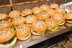 Catering at event - served table with hamburgers snack Royalty Free Stock Photography