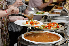Catering food. Catering - food, plate and hand Stock Photo