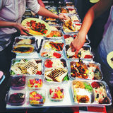 Catering food. People taking catering food at event Stock Photos