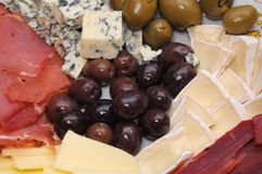 Catering food. Cheese, olives and jerked meat Stock Photos