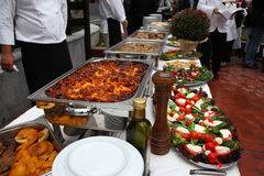 Catering food table set decoration. Buffet catering food arangement on table Stock Photos