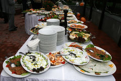 Catering food table set decoration. Buffet catering food arangement on table Royalty Free Stock Photos