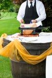 waiter cuts the ham Royalty Free Stock Photos
