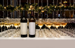 Catering. Glasses and bottle with white and red wine. Royalty Free Stock Photos