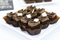Catering Miniature chocolate meringue cakes with cream and stock image