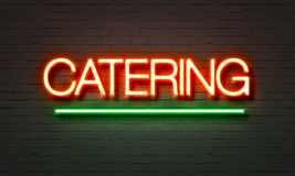 Catering neon sign on brick wall background. Royalty Free Stock Photo