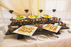 Catering for party. Close up of sandwiches, appetizers and fruit Stock Photos