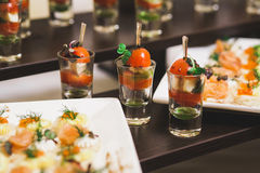 Catering for party. Close up of sandwiches, appetizers and fruit Royalty Free Stock Photos