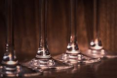 Catering, party concept: close-up image of wine glasses on a dark wooden background. Selective focus Royalty Free Stock Images