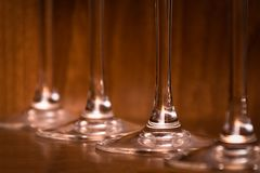 Catering, party concept: close-up image of wine glasses on a dark wooden background. Selective focus Royalty Free Stock Image
