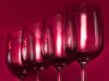Catering, party concept: wine glasses on a ruby background. Selective focus Royalty Free Stock Image