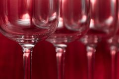 Catering, party concept: wine glasses on a ruby background. Selective focus Stock Photos
