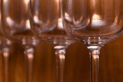 Catering, party concept: wine glasses on a wooden background. Selective focus Stock Photos