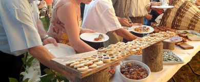 Catering. People serving themselves in a meeting event, catering set Stock Photo