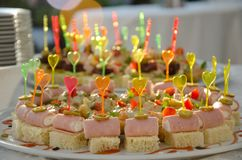 Catering with plastic colorful heart shape sticks. On small sandwiches Royalty Free Stock Image