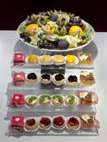 Catering platters. Of small pastries and fruit bowl Stock Images