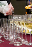 Catering - pouring out the wine. Catering - woman's hand pouring out the wine Stock Photo