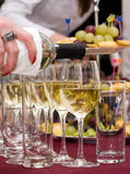 Catering - pouring out the wine. Catering - woman's hand pouring out the wine Stock Images