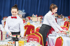 Catering restaurant waitress serving table with food Royalty Free Stock Photos