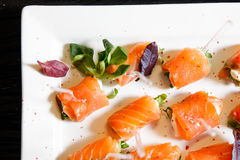 Catering salmon basil canape. White plate Royalty Free Stock Photo