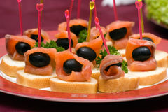 Catering - salmon with olive appetizer. Catering - salmon with olive canape appetizer Royalty Free Stock Image