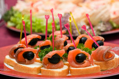 Catering - salmon with olive appetizer. Catering - salmon with olive canape appetizer Stock Image