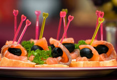 Catering - salmon with olive appetizer. Catering - salmon with olive canape appetizer Stock Photos