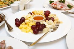 Catering - served table with cheese plate Royalty Free Stock Photography