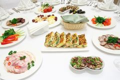 Catering - served table with various cold appetizers Royalty Free Stock Photos