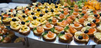 Catering - served table with various snacks, canape and appetize Stock Photos